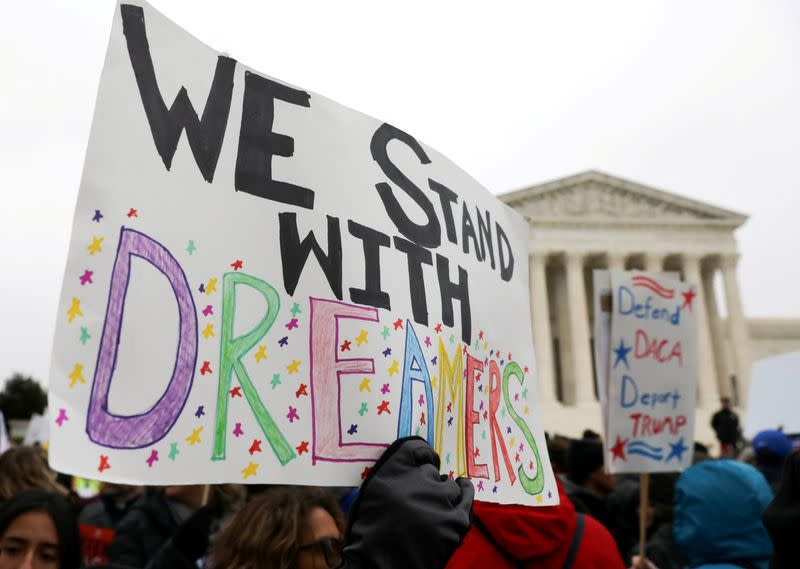 FILE PHOTO: Demonstrators rally outside the U.S. Supreme Court during oral arguments in cases regarding the Trump administration's bid to end the DACA program in Washington