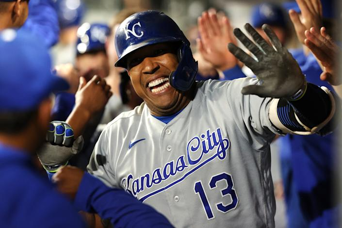 SEATTLE, WASHINGTON - AUGUST 27: Salvador Perez #13 of the Kansas City Royals celebrates with teammates in the dugout after hitting a grand slam to tie the game 5-5 against the Seattle Mariners in the fifth inning at T-Mobile Park on August 27, 2021 in Seattle, Washington. (Photo by Abbie Parr/Getty Images)