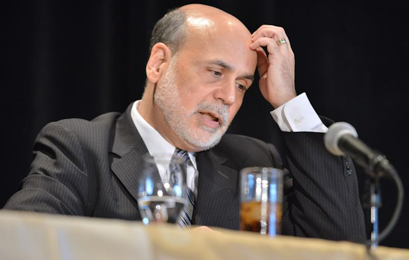 Federal Reserve Board Chairman Ben Bernanke responds to a question during a talk at the National Bureau of Economic Research Wednesday, July 10, 2013, in Cambridge, Mass. Bernanke spoke after the markets closed with stocks fluctuating between small gains and losses Wednesday morning, before the Federal Reserve released minutes from its most recent meeting. (AP Photo/Josh Reynolds)