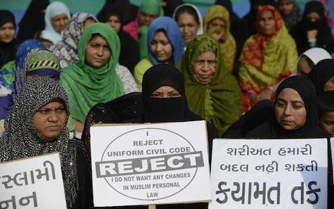 <span>File picture from November 2016 shows Indian Muslim women at a rally to oppose the Uniform Civil Code (UCC), which would outlaw the practice of 'triple talaq'</span> <span>Credit: SAM PANTHAKY/AFP </span>