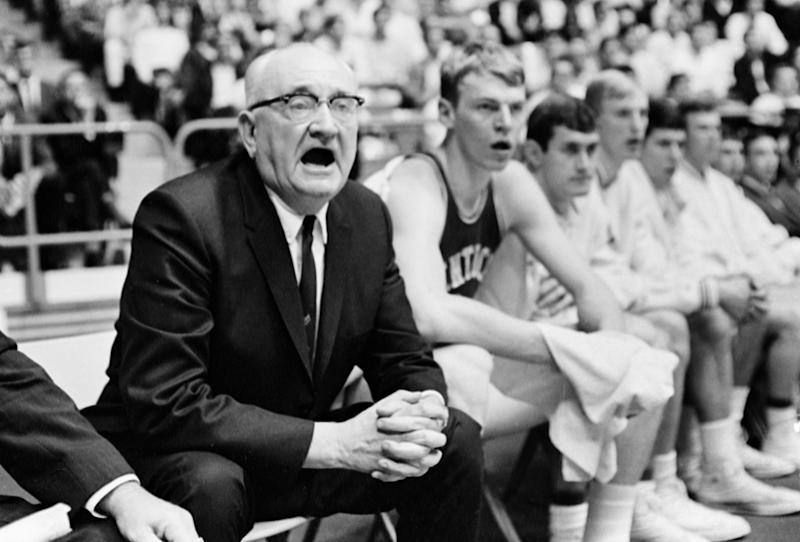 "**ADVANCE FOR WEEKNED OF JAN 21-22 -- FILE** Kentucky coach Adolph Rupp clasps his hands and offers verbal support to his nationally ranked Wildcats against Mississippi at Oxford, Miss., in this Jan. 29, 1968, file photo. Actor Jon Voight's portrayal of the late Adolph Rupp in the motion picture ""Glory Road"" has opened a sensitive debate whether the legendary coach was a racist. (AP Photo/File)"