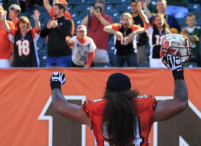 Cincinnati Bengals defensive tackle Domata Peko runs off the field after the Bengals defeated the Green Bay Packers 34-30 in an NFL football game, Sunday, Sept. 22, 2013, in Cincinnati. (AP Photo/Tom Uhlman)