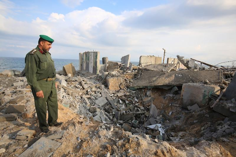 A Palestinian security man surveys the destruction from an Israeli air strike on the southern Gaza Strip town of Rafah on October 17, 2018 (AFP Photo/SAID KHATIB)