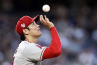Los Angeles Angels pitcher Shohei Ohtani tosses the ball during the first inning of the team's baseball game against the New York Yankees on Wednesday, June 30, 2021, in New York. (AP Photo/Adam Hunger)