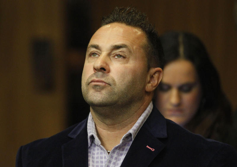 "FILE - In this Oct. 15, 2014 file photo, Giuseppe ""Joe"" Giudice, from the television show ""Real Housewives of New Jersey"", stands during a hearing in the Passaic County Courthouse in Paterson, N.J.  A federal court ruled this week that Giudice can stay in the U.S. as his appeal progresses.  Giudice and his wife, Teresa, pleaded guilty in 2014 to financial fraud. Teresa Giudice served her sentence first and was released in December 2015. In an order published Wednesday, May 22, 2019,  the 3rd U.S. Circuit Court of Appeals in Philadelphia delayed Giudice's deportation.  (William Perlman/NJ Advance Media via AP, Pool)"