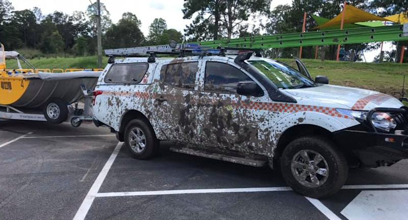 A Logan City SES vehicle parked at Loganlea Boat Ramp with mud on the door.