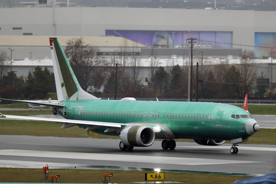 FILE - In this Wednesday, Dec. 11, 2019, file photo, a Boeing 737 Max being built for Norwegian Air International taxis for a test flight, at Renton Municipal Airport in Renton, Wash. Newly released Boeing documents show that company employees knew about problems with flight simulators for the now-grounded 737 Max jetliner and talked about misleading regulators. (AP Photo/Ted S. Warren, File)