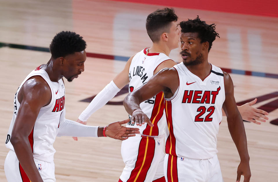 LAKE BUENA VISTA, FLORIDA - SEPTEMBER 17: Jimmy Butler #22 of the Miami Heat reacts during the fourth quarter against the Boston Celtics in Game Two of the Eastern Conference Finals during the 2020 NBA Playoffs at AdventHealth Arena at the ESPN Wide World Of Sports Complex on September 17, 2020 in Lake Buena Vista, Florida. NOTE TO USER: User expressly acknowledges and agrees that, by downloading and or using this photograph, User is consenting to the terms and conditions of the Getty Images License Agreement.  (Photo by Kevin C. Cox/Getty Images)