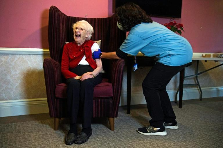 Ellen Prosser, 100, receives the Oxford/AstraZeneca vaccine in London on January 7
