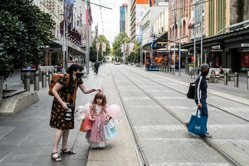 Melbourne residents pictured out and about during lockdown.