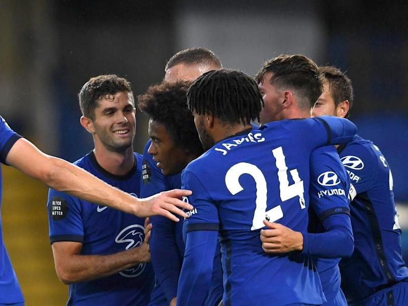 Chelsea celebrate after Willian doubles the lead: Getty