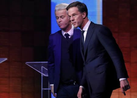 "Dutch far-right politician Geert Wilders of the PVV party and Dutch Prime Minister Mark Rutte (R) of the VVD Liberal party take part in the ""EenVandaag"" debate in Rotterdam, Netherlands, March 13, 2017.     REUTERS/Yves Herman"