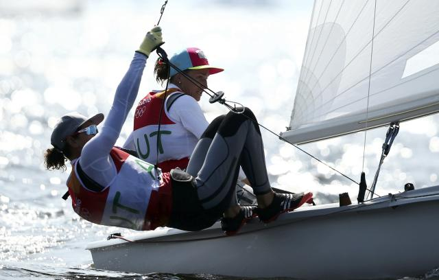 2016 Rio Olympics - Sailing - Preliminary - Women's Two Person Dinghy - 470 - Race 8/9/10 - Marina de Gloria - Rio de Janeiro, Brazil - 16/08/2016. Lara Vadlau (AUT) of Austria and Jolanta Ogar (AUT) of Austria compete. REUTERS/Benoit Tessier FOR EDITORIAL USE ONLY. NOT FOR SALE FOR MARKETING OR ADVERTISING CAMPAIGNS.