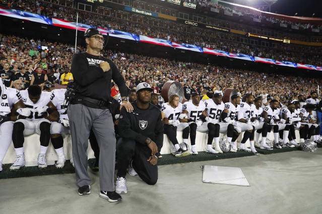 "The <a class=""link rapid-noclick-resp"" href=""/nfl/teams/oak/"" data-ylk=""slk:Oakland Raiders"">Oakland Raiders</a> hadn't planned on coming out for the national anthem. (AP Photo/Alex Brandon)"