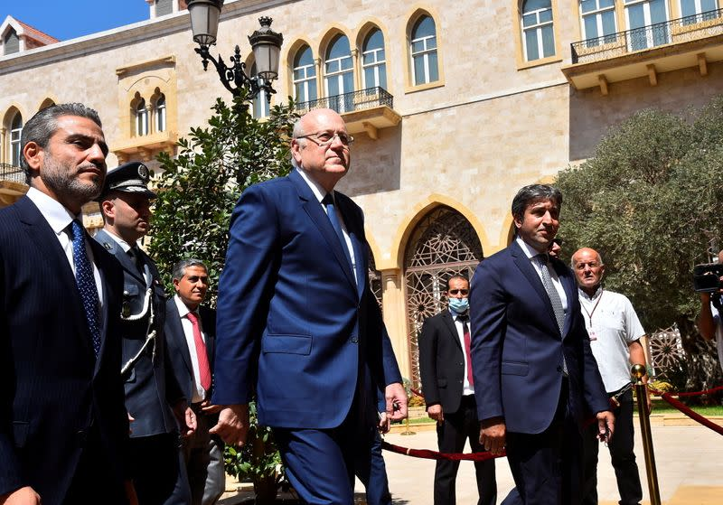 FILE PHOTO: Lebanon's new Prime Minister Najib Mikati walks during an official ceremony at the Government Palace in Beirut