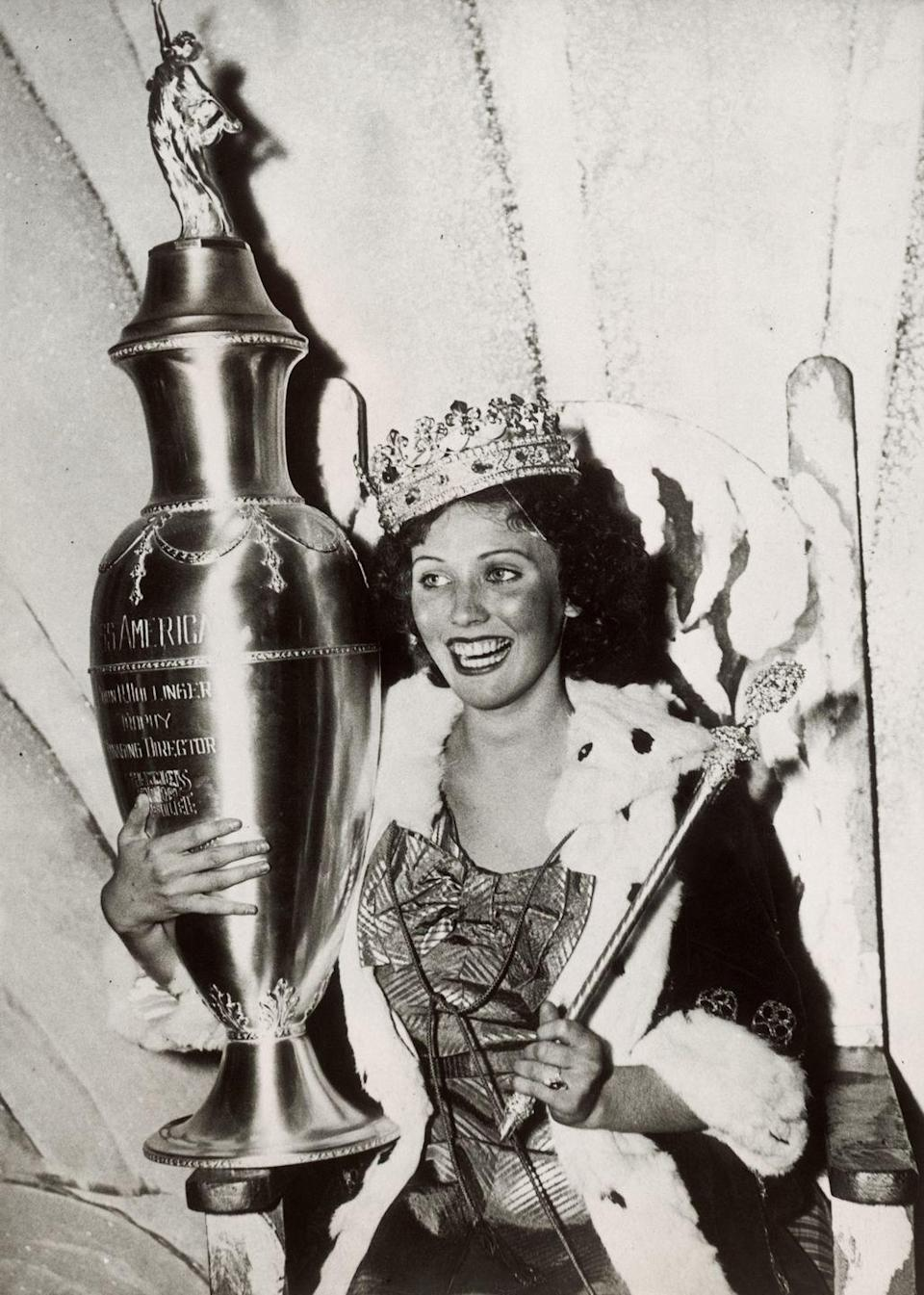 <p>Henrietta Leaver from Pittsburgh placed the ceremonial robe and crown over her gold lamé evening gown when she was crowned Miss America in 1935. </p>