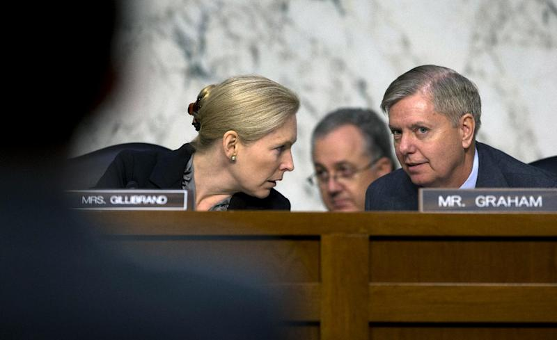 FILE – In this March 13, 2013, file photo Chair of the Senate subcommittee on Personnel, Sen. Kirsten Gillibrand, D-N.Y., left, talks with the subcommittee's ranking Republican, Sen. Lindsey Graham, R-S.C., on Capitol Hill in Washington during the subcommittee's hearing on sexual assault in the military. American military commanders wield substantial power to discipline the troops they lead, but an epidemic of sexual assaults roiling the armed forces has Congress about to rein in that authority. The question is how much? (AP Photo/Carolyn Kaster, File)