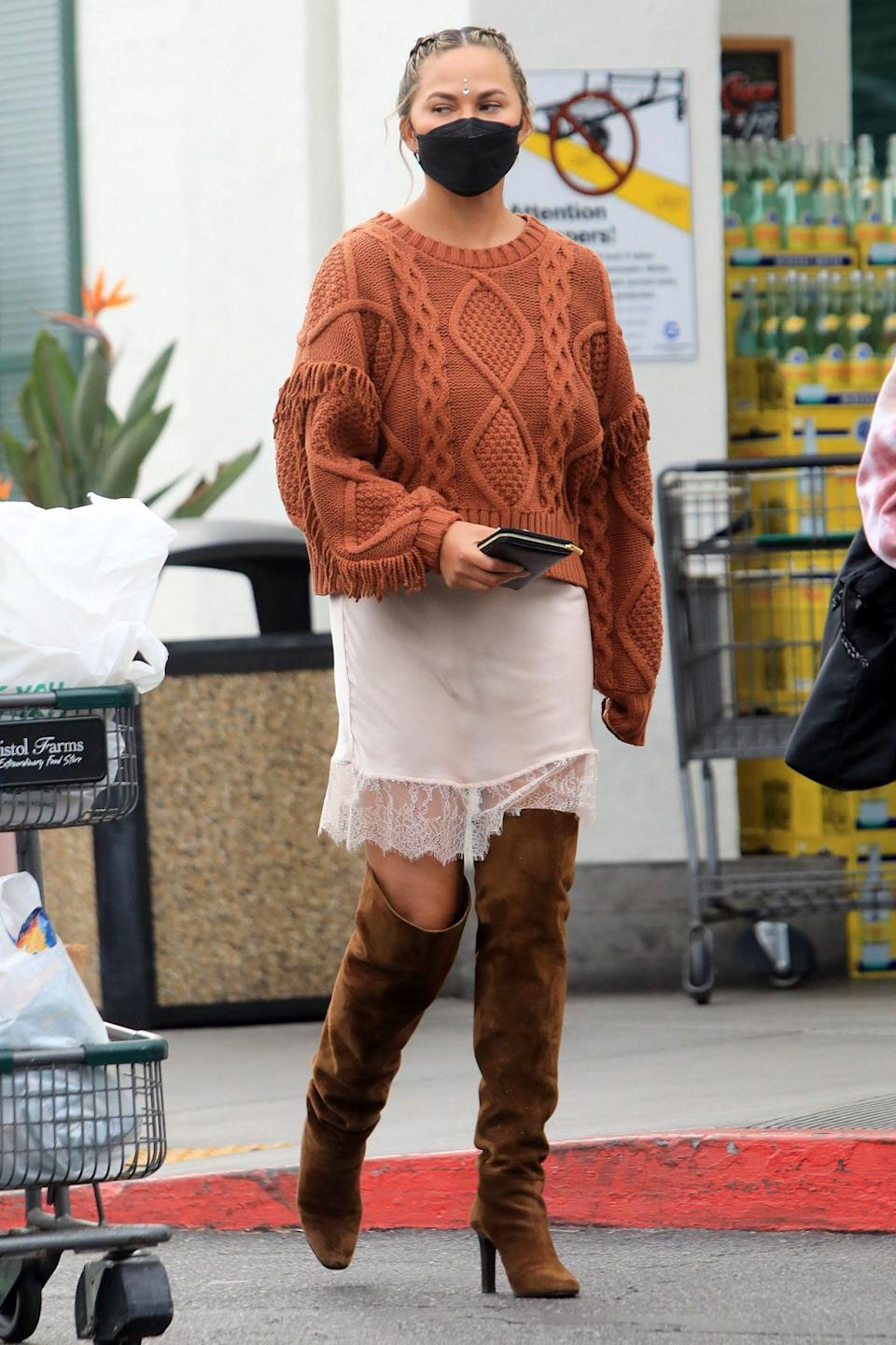 <p>Chrissy Teigen wears a brown sweater and matching boots while out grocery shopping at Bristol Farms in Beverly Hills on Tuesday.</p>