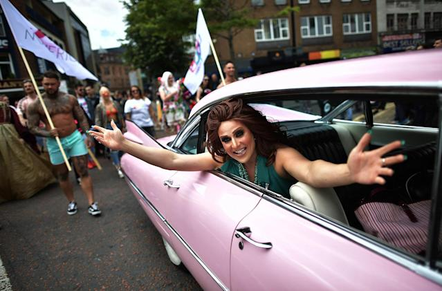 <p>Drag queen Lady Portia Di'Monte waves as she takes part in the Belfast Gay Pride march on August 5, 2017 in Belfast, Northern Ireland. (Photo: Charles McQuillan/Getty Images) </p>