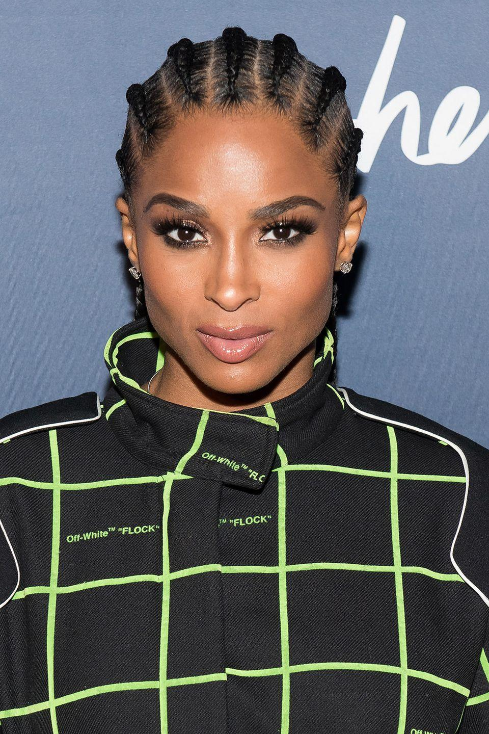 <p>Ciara wears traditional cornrows, braiding at the top of the hairline and going all the way to the nape of her neck. </p>