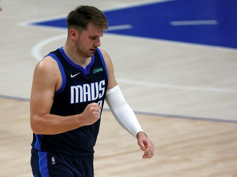 Dallas star Luka Doncic finished with a triple double that included 20 rebounds as the Mavericks slipped past the Washington Wizards 125-124