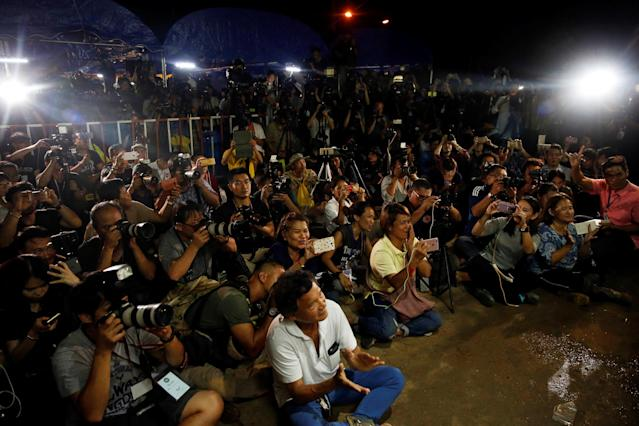 <p>Journalists celebrate before a news conference near Tham Luang cave complex in the northern province of Chiang Rai, Thailand, July 10, 2018. (Photo: Soe Zeya Tun/Reuters) </p>