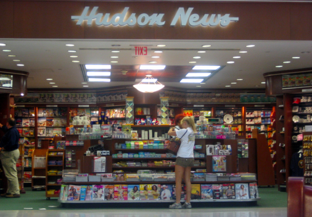 A traveler shops at Hudson News (Source: Wikimedia Commons/ David Boyle)