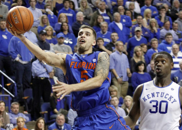 Florida's Scottie Wilbekin (5) shoots near Kentucky's Julius Randle (30) during the second half of an NCAA college basketball game on Saturday, Feb. 15, 2014, in Lexington, Ky. Florida won 69-59. (AP Photo/James Crisp)