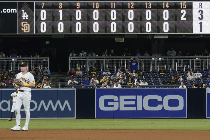 The San Diego Padres play the Los Angeles Dodgers during the fifteenth inning of a baseball game Thursday, Aug. 26, 2021, in San Diego. (AP Photo/Gregory Bull)