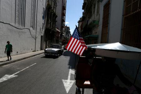 A U.S. flag is seen on a bicycle taxi, in Havana