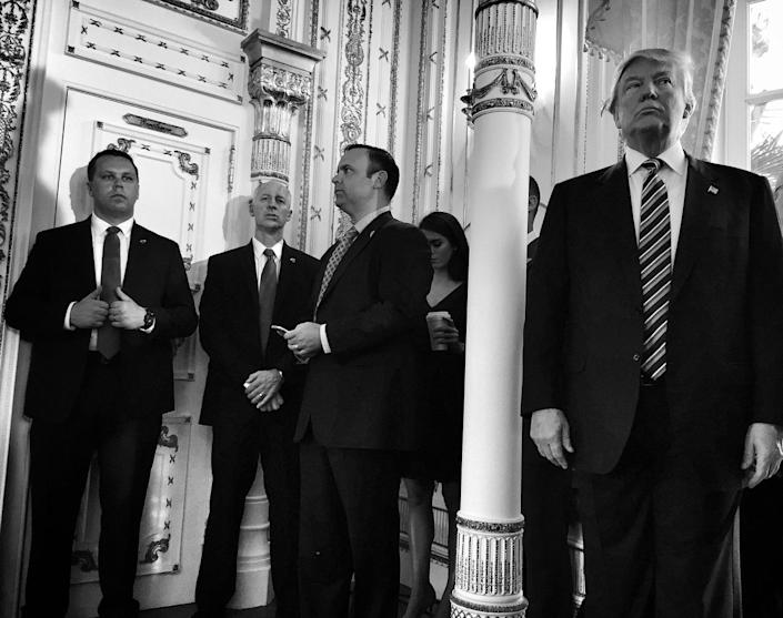 <p>Donald Trump stands with members of his staff and the Secret Service during a press conference on March 11 at the Mar-a-Lago Beach Club, in Palm Beach, Fla. (Photo: Holly Bailey/Yahoo News) </p>