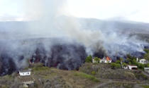 In this image made from video provided by OVERON, lava is seen after a volcanic eruption in La Palma, Spain, Monday, Sept. 20, 2021. Giant rivers of lava are tumbling slowly but relentlessly toward the sea after a volcano erupted on a Spanish island off northwest Africa. The lava is destroying everything in its path Monday, but prompt evacuations helped avoid casualties after Sunday's eruption. (OVERON via AP)