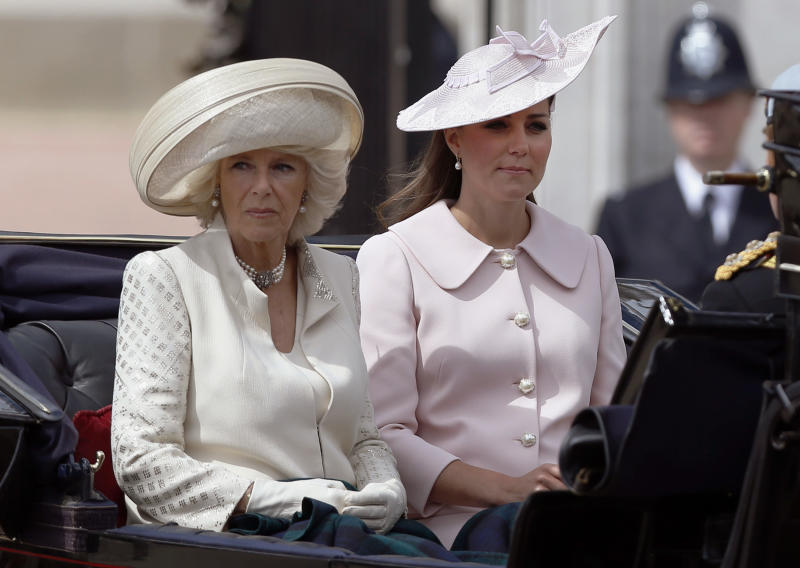 """Britain's Camilla, Duchess of Cornwall, left, and Kate, Duchess of Cambridge leave Buckingham Palace in a horse drawn carriage for the Trooping The Colour parade, at the Horse Guards Parade in London, Saturday, June 15, 2013. Queen Elizabeth II is celebrating her birthday with traditional pomp and circumstance _ but without her husband by her side. More than 1,000 soldiers, horses and musicians are taking part in the parade known as """"Trooping the Color,"""" an annual ceremony (AP Photo/Sang Tan)"""
