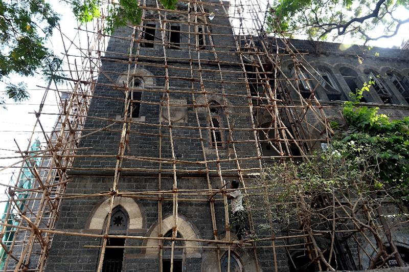 An Indian mason stands on scaffolding at the under-renovation Lord Harris Higher Secondary Marathi School in Mumbai (AFP Photo/Indranil Mukherjee)