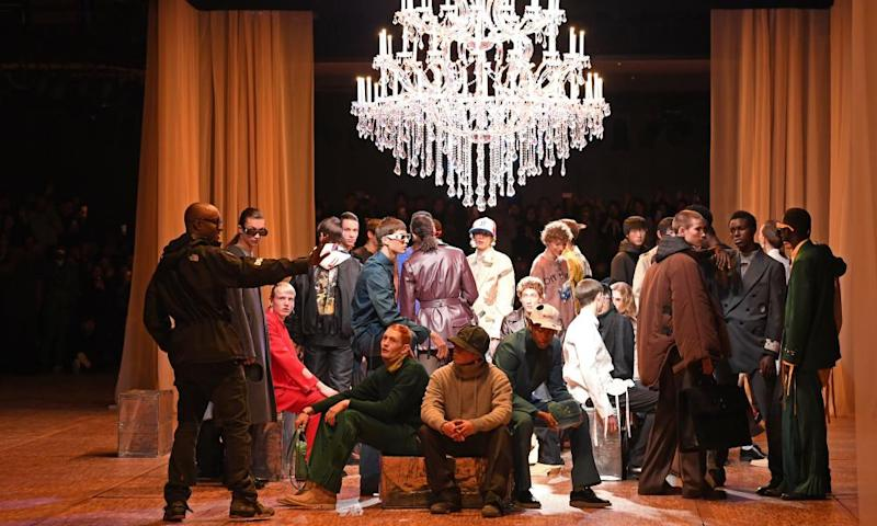 Models gathered under chandelier with Abloh, wearing sunglasses