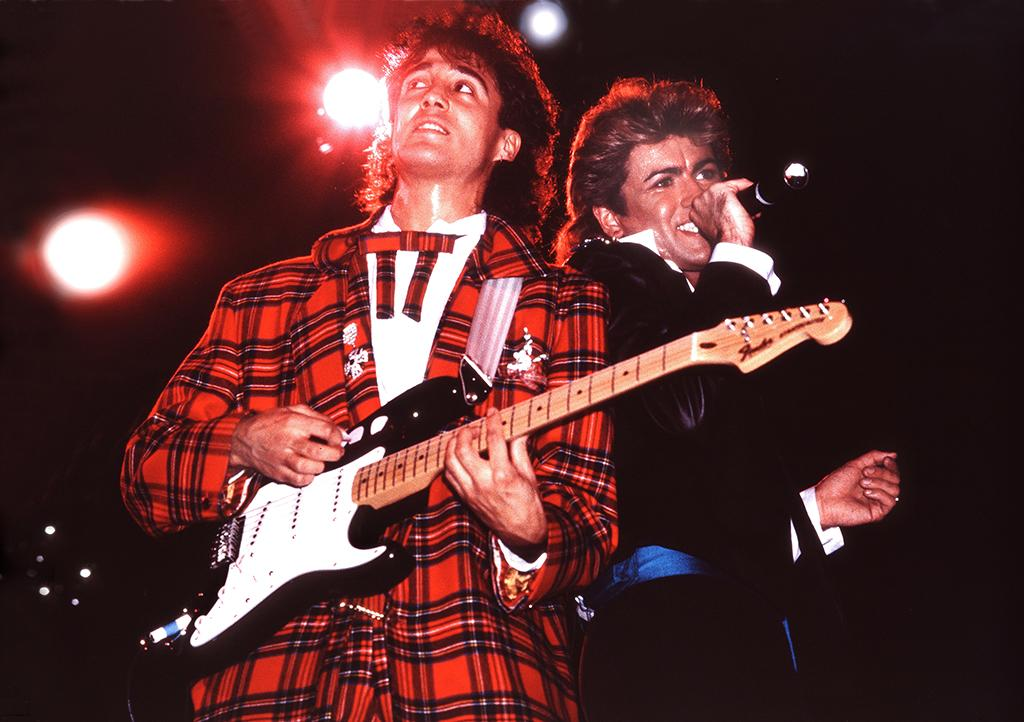 <p>Andrew Ridgeley and George Michael of Wham! perform onstage in London in 1984. (Photo: Phil Dent/Redferns) </p>