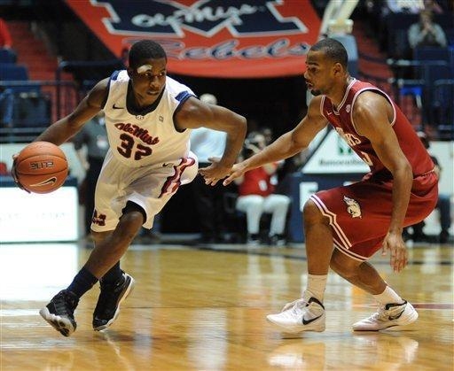 Mississippi's Jarvis Summers (32) works the ball past by Arkansas' Rickey Scott (3) during an NCAA college basketball game in Oxford, Miss., Wednesday, Jan. 11, 2012. (AP Photo/Oxford Eagle, Bruce Newman) MAGS OUT, NO SALES, MANDATORY CREDIT