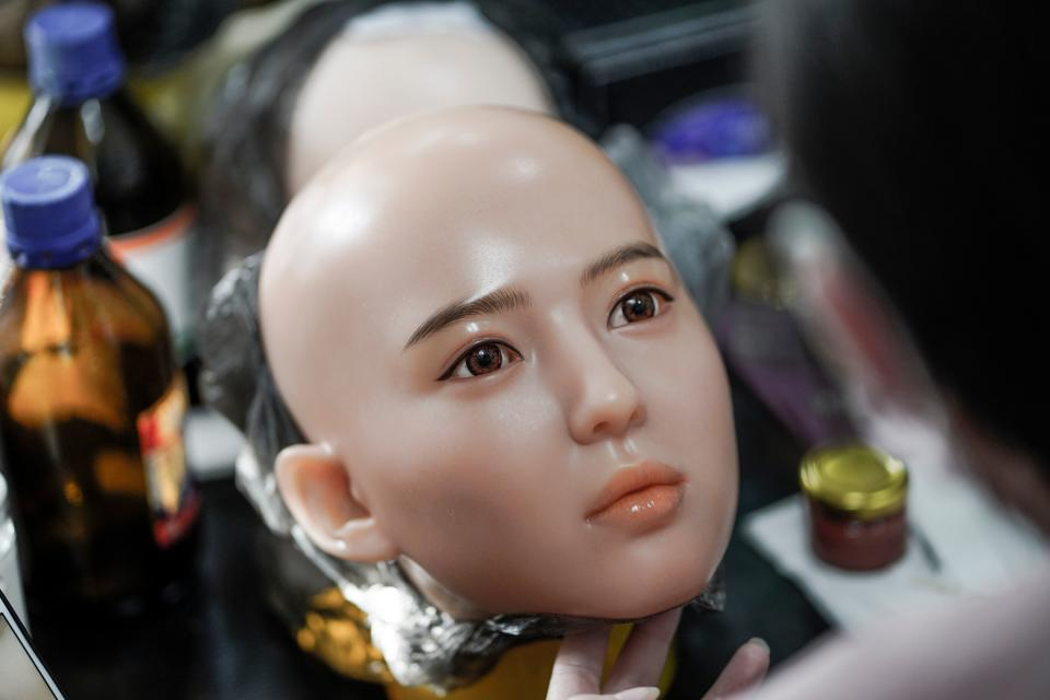 "This photo taken on February 1, 2018 shows a worker painting the face of a silicone doll at a factory of EXDOLL, a firm based in the northeastern Chinese port city of Dalian. With China facing a massive gender gap and a greying population, a company wants to hook up lonely men and retirees with a new kind of companion: ""Smart"" sex dolls that can talk, play music and turn on dishwashers. / AFP PHOTO / FRED DUFOUR / TO GO WITH China-sex-lifestyle, FOCUS by Joanna CHIU        (Photo credit should read FRED DUFOUR/AFP/Getty Images)"