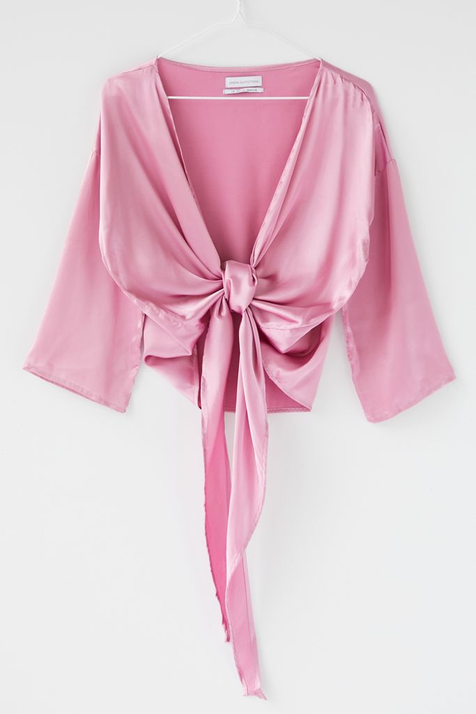 "<br><br><strong>Urban Outfitters</strong> Nicole Satin Tie Front Top, $, available at <a href=""https://go.skimresources.com/?id=30283X879131&url=https%3A%2F%2Fwww.urbanoutfitters.com%2Fshop%2Fuo-nicole-satin-tie-front-top"" rel=""nofollow noopener"" target=""_blank"" data-ylk=""slk:Urban Outfitters"" class=""link rapid-noclick-resp"">Urban Outfitters</a>"