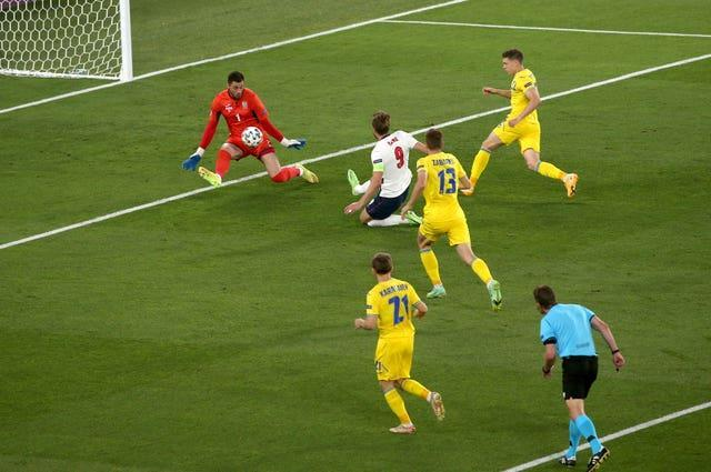 Harry Kane, centre, slides in to give England an early lead