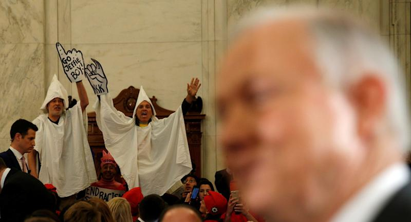Protesters dressed as Klansmen disrupt the start of a Senate Judiciary Committee confirmation hearing for U.S. Attorney General nominee Jeff Sessions on Jan. 10, 2017.