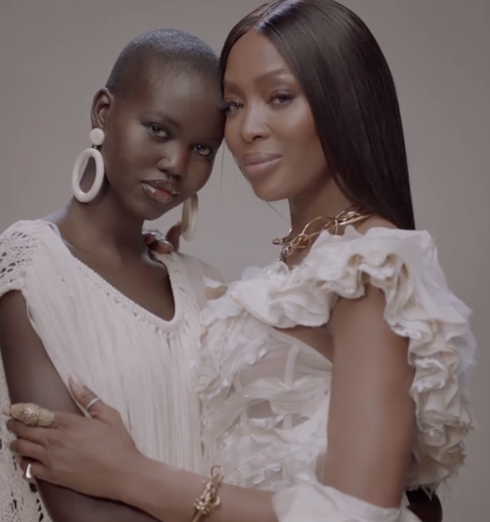 <p>Model Naomi Campbell wears a white ruffled gown by Alexander McQueen. </p>