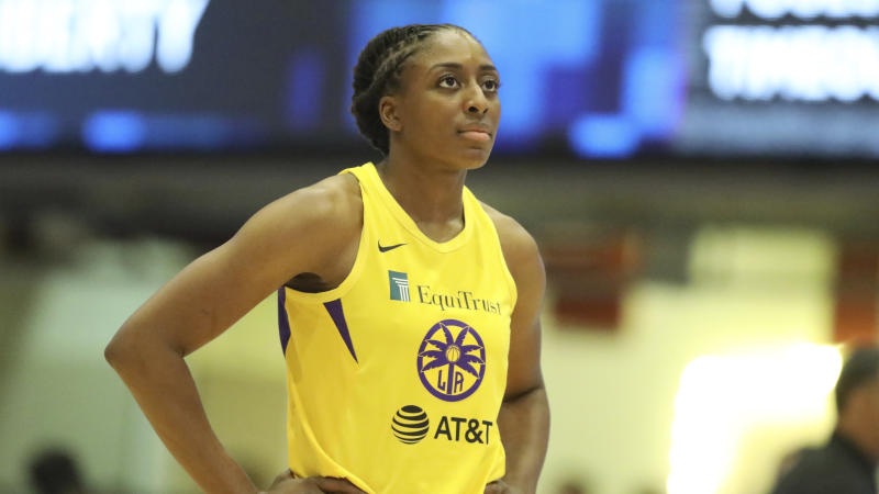 A man sprinted at Nneka and Chiney Ogwumike on the floor while holding something in his hand, though was quickly brought down by security.
