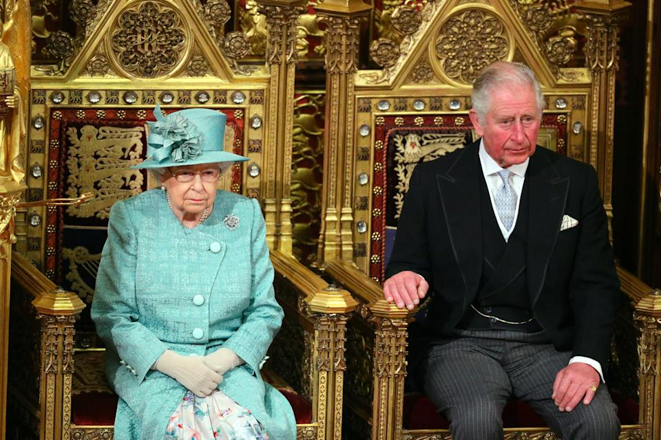 Queen Elizabeth II and the Prince of Wales sit in the chamber ahead of the State Opening of Parliament by the Queen, in the House of Lords at the Palace of Westminster in London.