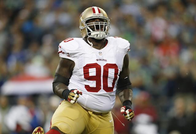 San Francisco 49ers' defensive end Glenn Dorsey celebrates a tackle during the first half of an NFL football game against the Seattle Seahawks, Sunday, Sept. 15, 2013, in Seattle. (AP Photo/John Froschauer)