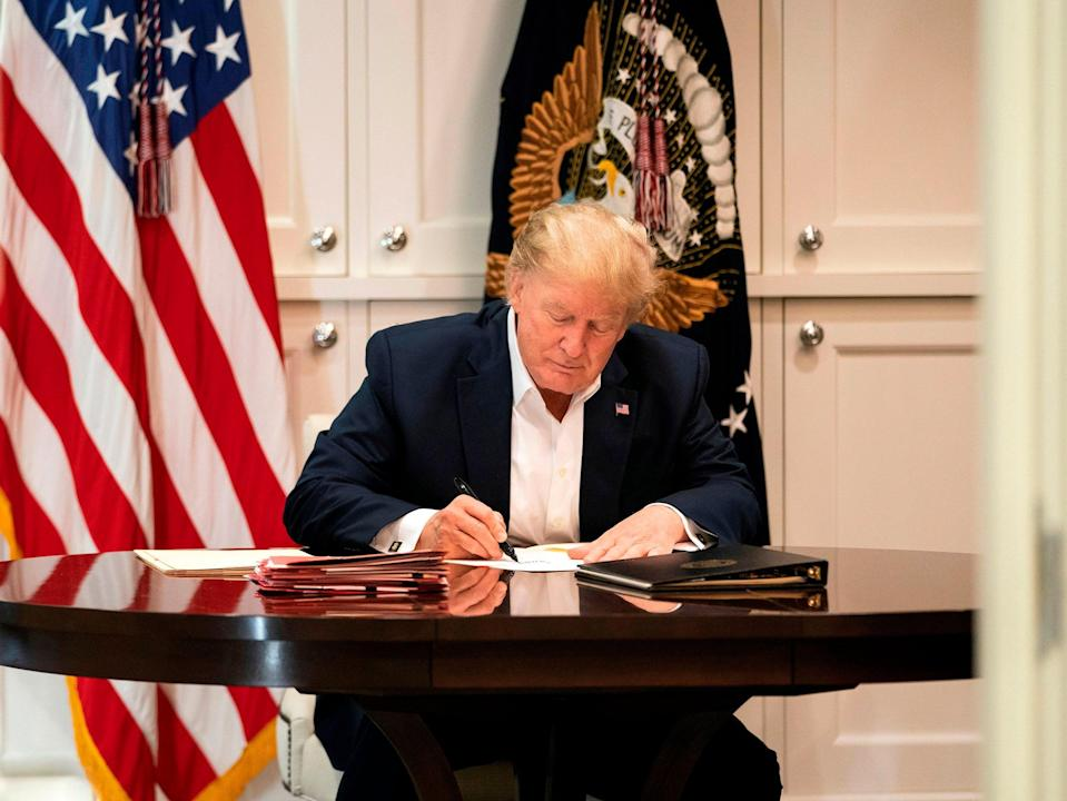 This White House handout photo released 4 October 2020 shows US president Donald Trump working in the Presidential Suite at Walter Reed National Military Medical Centre in Bethesda, Maryland on 3 October 2020, after testing positive for Covid-19 ((AFP photo /The White House/Joyce N. Boghosian/Handout))