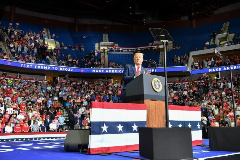 US President Donald Trump disregarded his own government's guidelines and held a rally in Tulsa, Oklahoma on June 20, 2020 -- although turnout was significantly lower than anticipated (AFP Photo/Nicholas Kamm)