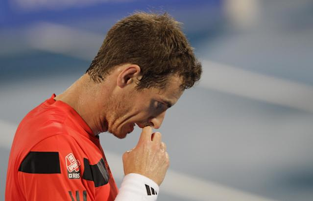 Andy Murray of Britain reacts during a match against Jo-Wilfried Tsonga of France during the first day of the Mubadala World Tennis Championship in Abu Dhabi, United Arab Emirates, Thursday Dec. 26, 2013. (AP Photo/Kamran Jebreili)