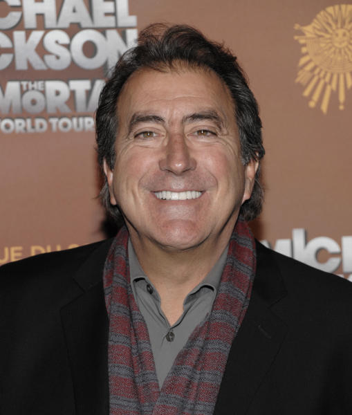 "FILE - In this Jan. 27, 2012 file photo, Director Kenny Ortega arrives at the opening night of the Michael Jackson The Immortal World Tour in Los Angeles. Ortega broke down while describing Jackson as a ""lost boy"" after a rehearsal session in which his friend and collaborator appeared frail and shivering. The director's testified in a Los Angeles courtroom in a civil trial against concert promoter AEG Live LLC on Wednesday, July 10, 2013. (AP Photo/Dan Steinberg, File)"