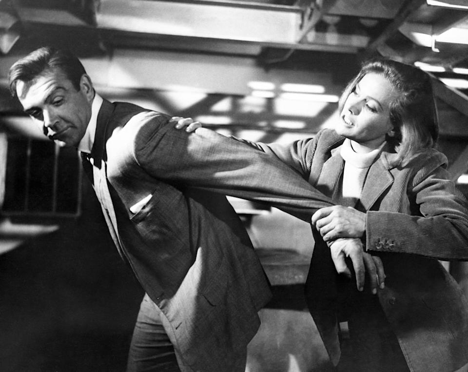 Sean Connery and Honor Blackman film a scene for Goldfinger at Pinewood Studios in Buckinghamshire. It's their first meeting, but that doesn't stop Pussy Galore from putting a restraining arm lock on James Bond. This is an incident from the new film, Goldfinger.   (Photo by PA Images via Getty Images)